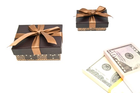closed ribbon: two brown gift boxes and banknotes on white background Stock Photo