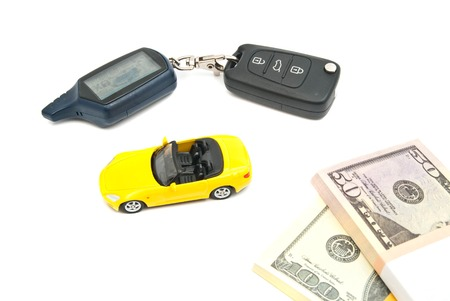 afford: yellow car, keys and banknotes on white