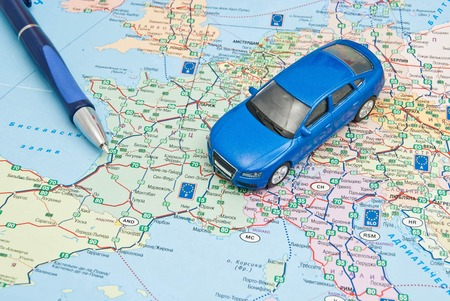 blue car and pen on the map of Europe Stock Photo