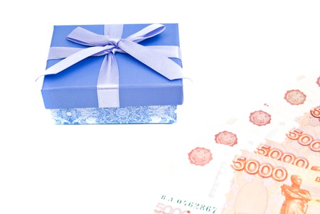 blue gift box: blue gift box and banknotes on white closeup Stock Photo