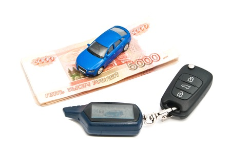 afford: blue car, keys and Russian banknotes on white background