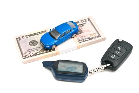 car keys, blue car and money on white background