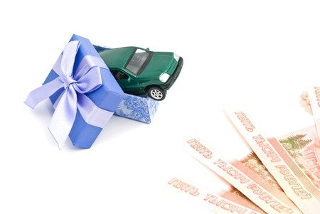 blue gift box: green car in blue gift box and banknotes on white