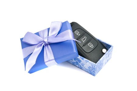 car keys in blue gift box on white background