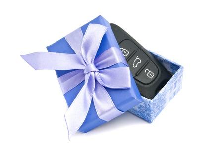 blue gift box: car keys in blue gift box on white Stock Photo