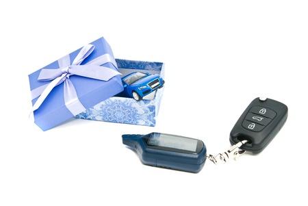 blue gift box: car keys, blue car and blue gift box on white background