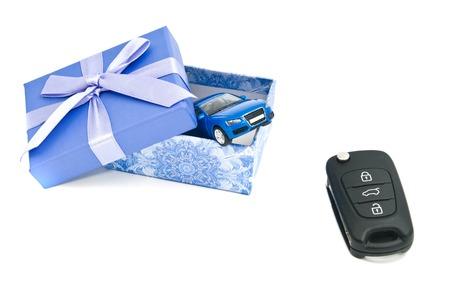 blue gift box: car keys, blue car and blue gift box on white