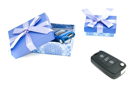 afford: car keys, blue car and blue gift boxes on white Stock Photo