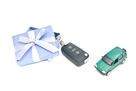 gift box, car and keys on white background Stock Photo