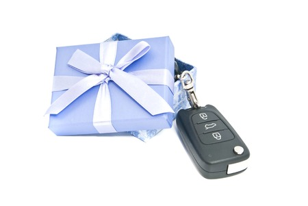 afford: gift box and car keys on white Stock Photo