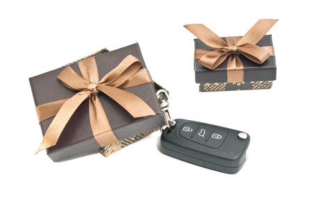 two brown gift boxes and keys on white Stock Photo