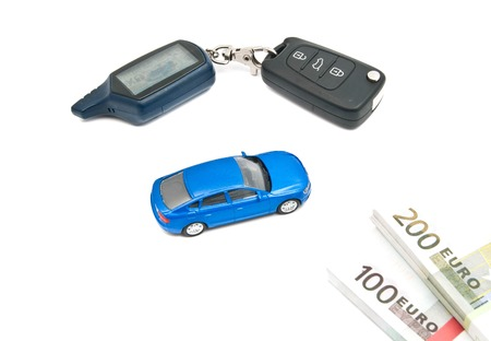 afford: blue car, keys and banknotes on white background Stock Photo