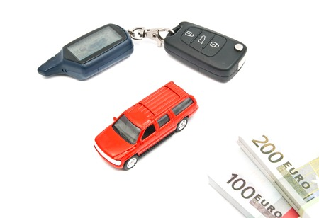 afford: red car, banknotes and keys closeup on white Stock Photo