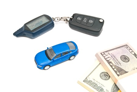 blue car, keys and money on white background photo