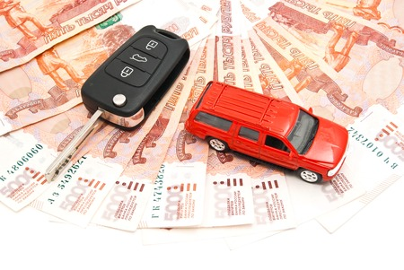 red car, keys and banknotes closeup on white Stock Photo