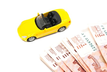 afford: yellow car and banknotes on white background Stock Photo