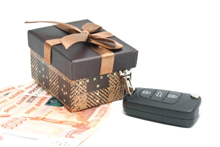 brown gift box, keys and banknotes on white background photo