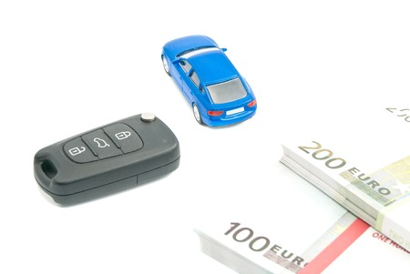 afford: car keys, blue car and euro notes on white background