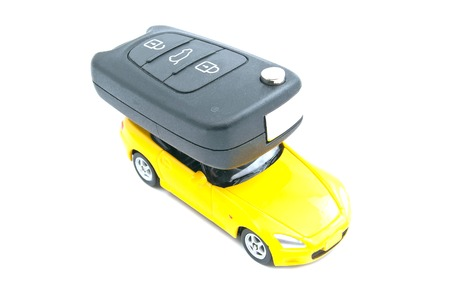 yellow car: yellow car and car keys on white