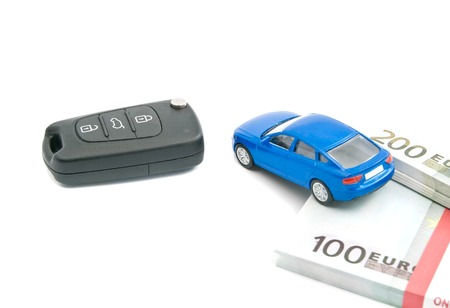 afford: black car keys, blue car and euro banknotes on white