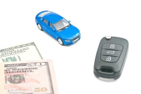afford: blue car, black car keys and dollar banknotes on white