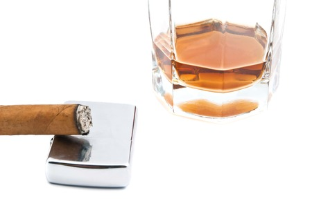 cognac, lighter and cigar on white background closeup