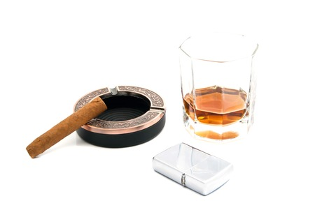 cigar in ashtray, cognac and lighter on white