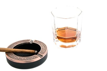 cigarillo in ashtray and whiskey on white closeup Stock Photo