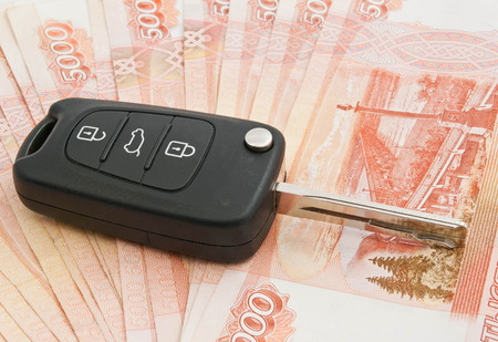 auto leasing: car keys and many Russian rubles banknotes