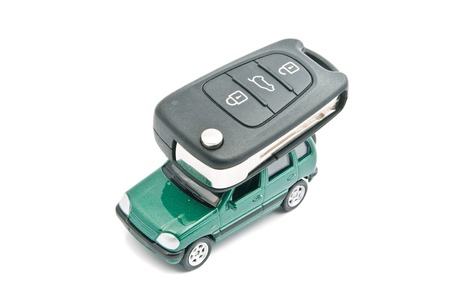 afford: Green car and car keys on white background