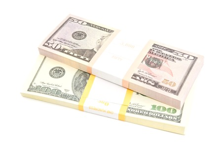 two packs of dollars banknotes on white Stock Photo