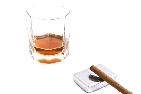 cognac: cognac, metal lighter and cigarillo on white