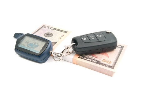 auto leasing: fifty dollars notes and car keys on white Stock Photo