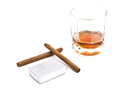 cognac, metal lighter and two cigarillos on white Stock Photo