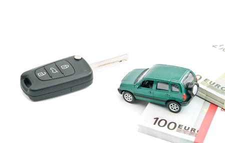 Green car, euro notes and car keys on white Stock Photo