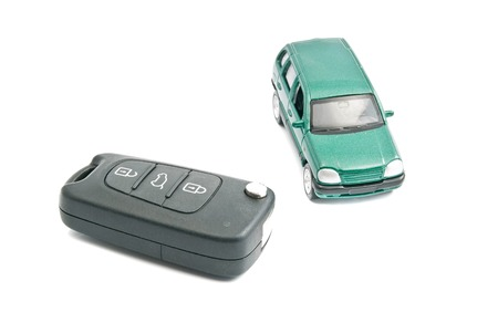 afford: car keys and green car on white background
