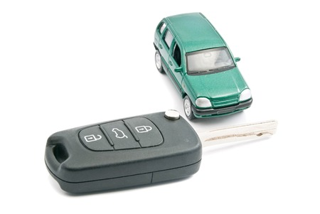 afford: black car keys and green car on white Stock Photo