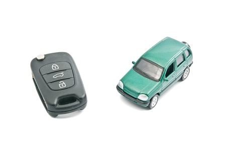 Green car and car keys with alarm on white Stock Photo