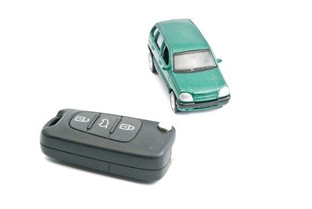 auto leasing: car keys with alarm and green car on white Stock Photo