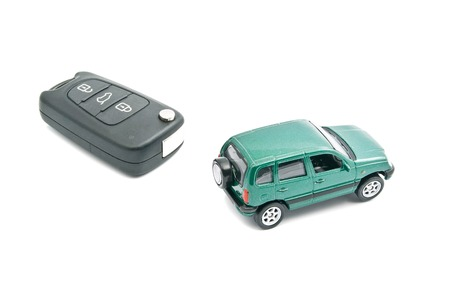 afford: Green car and car keys with alarm on white background Stock Photo