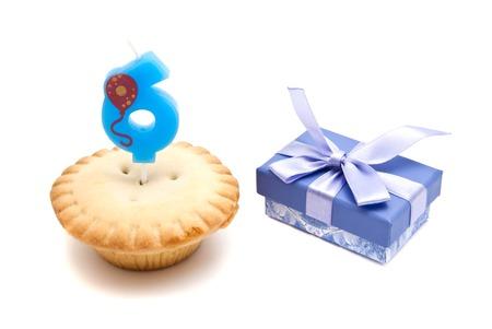 six years: six years birthday candle with cupcake  Stock Photo