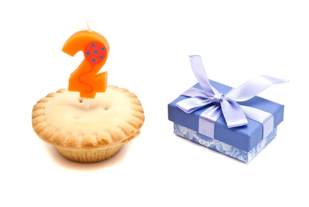 two years: two years birthday candle with cupcake and gift