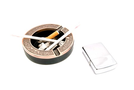 two  cigarettes in the ashtray and lighter