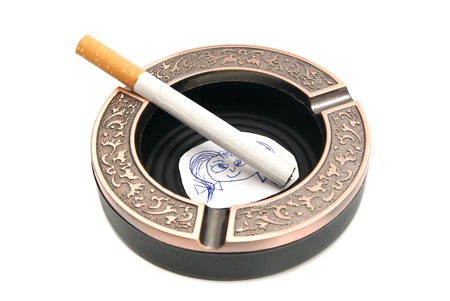 dependency: portrait of child and cigarette in ashtray Stock Photo