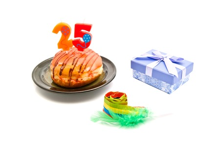 five years': donut with twenty five years birthday candle, whistle and gift on white