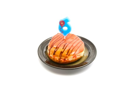 six years: donut with six years birthday candle on white background