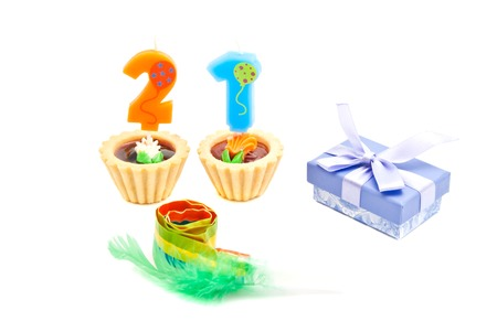 Cakes With Twenty One Years Birthday Candles Whistle And Gift On White Background Stock Photo
