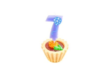 seven years: cake with seven years birthday candle on white background Stock Photo