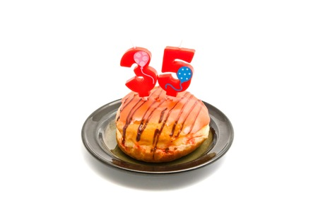 five years': donut with thirty five years birthday candle on white Stock Photo