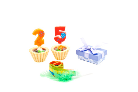 five years': cakes with twenty five years birthday candles, whistle and gift on white